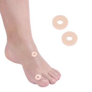 Paracalli protettivi per il piede tondi piccoli con foro centrale in lattice
